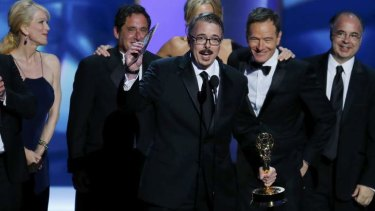 <i>Breaking Bad</i> executive producer Vince Gilligan, next to Bryan Cranston, accepts the Emmy award for Outstanding Drama Series.