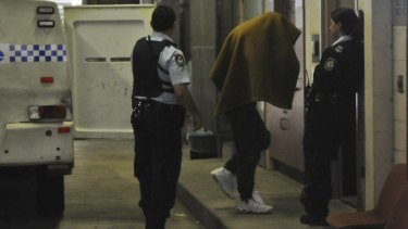 In court ... Kieran Loveridge is escorted to Burwood Court.