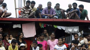 The long journey ahead: Sri Lankan asylum seekers look from a boat during an attempted journey to Australia.