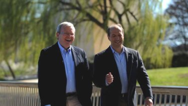 He's back... Kevin Rudd and the US Ambassador Jeff Bleich share a walk around Lake Burley Griffin in Canberra.