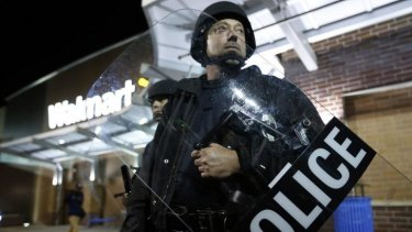 Heavy-handed? A policeman at riots in St Louis.