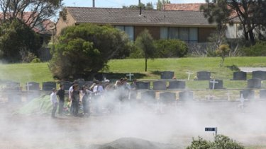 Smoke from burnouts at the funeral for road crash victim Aaron Bryce at a Warrnambool cemetery.