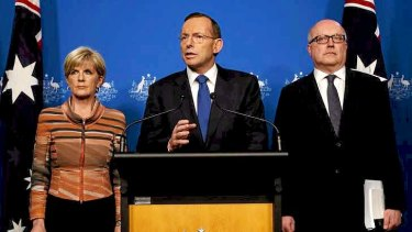 Prime Minister Tony Abbott with Foreign Minister Julie Bishop and Attorney-General Senator George Brandis in Canberra on Tuesday.