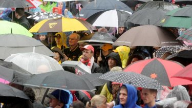 Resolute fans brave the wet for yesterday's grand final parade through Melbourne.