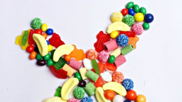 Wrong ... teens erroneously believe coloured lollies are carcinogenic says UK cancer group.