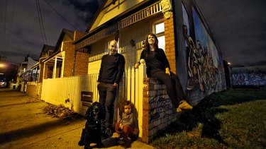 Collingwood residents John Mansour, Elyssa Henery and daughter Winter fear their house will be demolished.