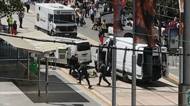 Bomb squad arrives at Bourke Street mall to investigate a suspicious package. Picture: Joe Armao