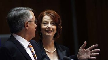 Julia Gillard and  Wayne Swan announce the deal.