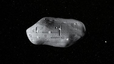 A computer-generated rendering of several small robotic spacecraft mining a potential near-Earth asteroid.