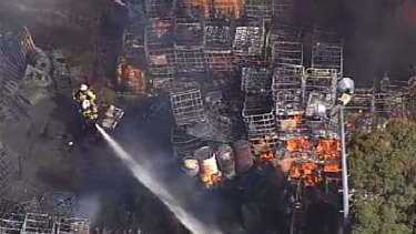 Firefighters try to control the blaze at the honey factory at  Richlands, southwest Brisbane.