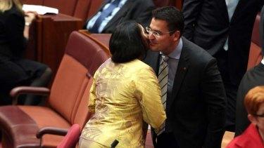 Fellow new Senator Nova Peris congratulates Senator Zed Seselja.