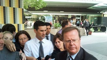Water Utilities Minister Stephen Robertson speaks to the media outside the flood inquiry.