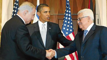 President Barack Obama watches as Israeli Prime Minister Benjamin Netanyahu and Palestinian President Mahmoud Abbas shake hands,