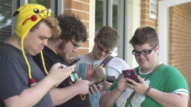 "Chase Brown, Keith Harrell, Christopher Van Avery and Alex Hicks play ""Pokemon Go"" at Gulf Coast State College in Panama City, Florida."