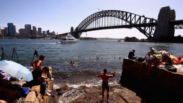 First in best dressed: People take up position in anticipation of New Year's Eve celebrations on Sydney Harbour.