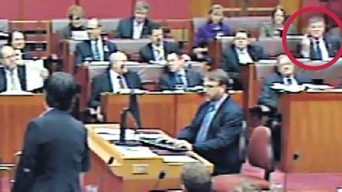 Gesture politics ... Bill Heffernan in the Senate yesterday. He said he was not sending a message to Penny Wong, at left in the foreground.