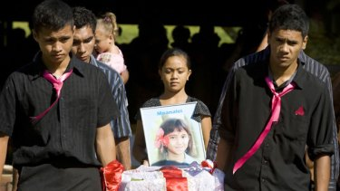 Local clan and community members attended the funeral of nine-year-old tsunami victim Moanalei Sarah Long, one of many burials in Western Samoa on Friday.
