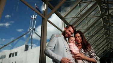 Jonathan McElwee and Bethan McElwee with their one-year-old daughter Aviana, who visited Parliament House in Canberra for a Spinal Muscular Atrophy Australia event on August 16, 2017.