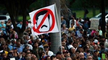 Anti-government demonstrators protest against Venezuelan President Nicolas Maduro in Caracas last month.