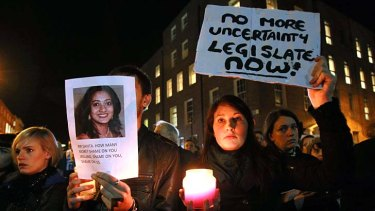 Candlelight vigil ... demonstrators gather outside the Irish parliament following the death of Savita Halappanavar, who had been refused an abortion.