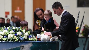 Senior Constable Forte is farewelled by his children.