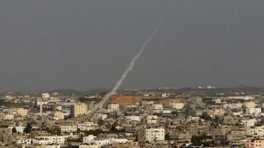 A Palestinian rocket heads for the Jewish town of Sderot, which the Israeli Government says has been subject to a relentless battery from Palestinian militants for eight years.