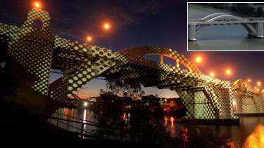 Putting the glitz on the bridge ... the William Jolly lit up for the light show, and inset, the bridge today.