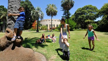 The Filippides and Datoy families enjoying a picnic in the Botanic Gardens.