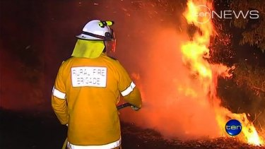 Firefighters battle a blaze in the Gold Coast hinterland where a body was later found.