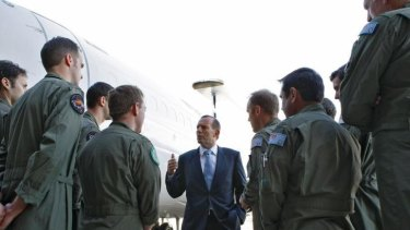 Tony Abbott speaking to troops at RAAF Base Williamtown: The Prime Minister has applauded Thursday morning's counter-terrorism operation, saying there was clear evidence the would-be terrorists planned to commit demonstration beheadings in Sydney.