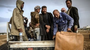 Syrian Kurds in the south-eastern town of Suruc in the Sanliurfa province flee approaching Islamic State fighters.