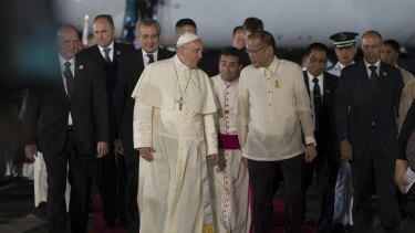 Pope Francis is greeted by Philippines' President Benigno Aquino (centre right) upon his arrival at Villamor Air Base for a state and pastoral visit, in Manila.