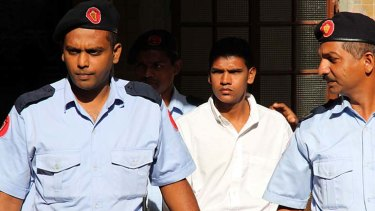 Accused ... Avinash Treebhoowoon, centre, leaves the court.