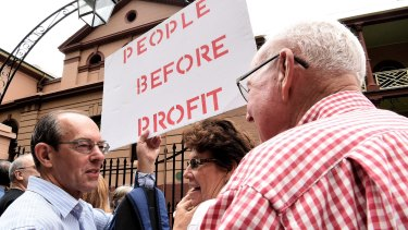 Protesters in front of NSW Parliament House demonstrating against the NSW government's privatisation of the Land Titles Registry.