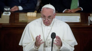 Pope Francis, pictured addressing a joint meeting of US Congress in September, has called for action on climate change.