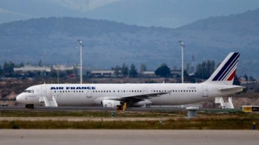 The Air France plane that was suspected of carrying a passenger with Ebola is seen on the runway at Madrid Barajas airport.