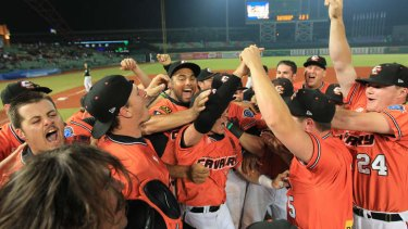 Canberra Cavalry players celebrate their win.