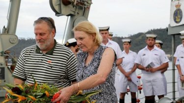 Robyn Rosenstrauss, whose great-uncle James Fette perished on the AE1, prepares with her husband, Graham, to throw flowers off the stern of HMAS Yarra on Wednesday.