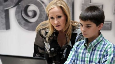 Harry Potter creator JK Rowling poses with a young boy during the launch of her new project.