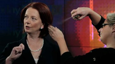 All that time: Julia Gillard has her hair adjusted by Channel 7 make-up artist Kim Anderson.