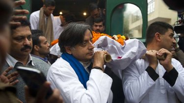 Indian MP Shashi Tharoor, centre, with relatives and friends as they carry the body of Tharoor's wife Sunanda to the cremation ceremony.