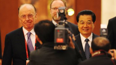Rupert Murdoch and Chinese President Hu Jintao arrive for the opening ceremony of the World Media Summit in Beijing.