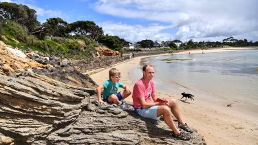 James Cotton with his son George and their dog Tilly at Point Lonsdale front beach.