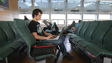 Daniel Brown 19 years old of Manly uses free Wi-Fi on the Queenscliff ferry to Manly.