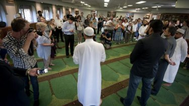 Imaan Uzii Akbar speaks to people gathered at the Holland Park mosque during an hour-long open session.