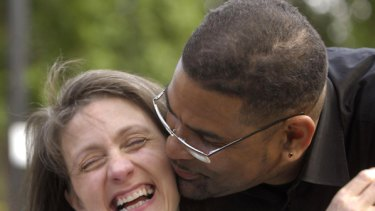 Debbie Purdy and her husband, Omar Puente, celebrate the news.