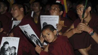 Tibetan Buddhist monks and nuns take part in a candlelight protest at temple in Dharamsala in March after the death of a young monk by self-immolation. Two more young monks died this week after setting themselves on fire in defence of their culture and heritage.