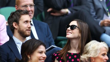 Wedding plans ... Anne Hathaway and Adam Shulman at Wimbledon this year.