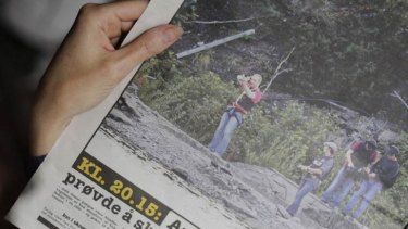 A Norwegian newspaper publishes photos of a restrained Anders Breivik re-enacting his slaughter of children on Utoeya.