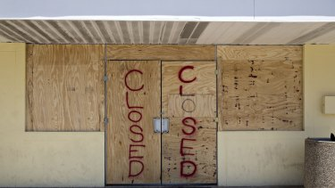 Plywood covers the doors of a 7-Eleven store ahead of Hurricane Irma in Madeira Beach, Florida.